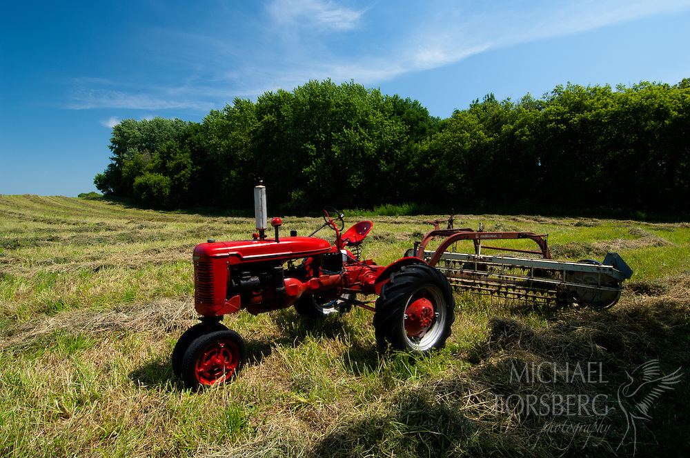 Farmall tractor and hayed field