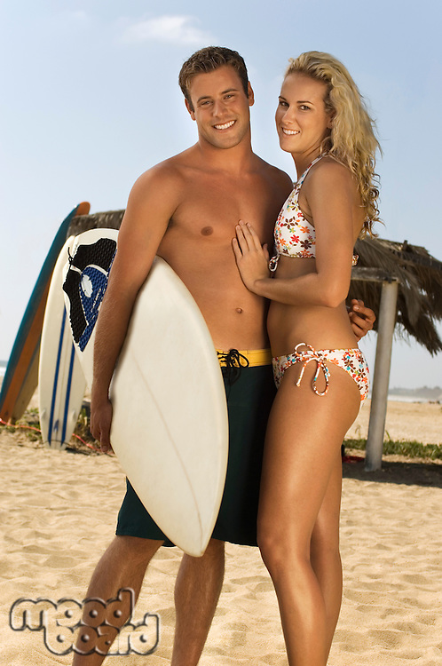 Attractive Surfing Couple on Beach