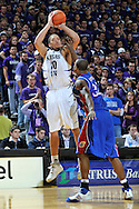Jan 30, 2008; Manhattan, KS, USA; Kansas State Wildcats forward Michael Beasley (30) hits a three point shot over Kansas Jayhawks forward Darnell Jackson (32) in the second half at Bramlage Coliseum in Manhattan, KS. Michael Beasley scored a game high 25 points. Mandatory Credit: Peter G. Aiken-US PRESSWIRE