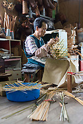 Taniwaki Satsuki weaves baskets at Iwao Chikuran's workshop in Beppu City, Oita Prefecture, Japan on Sept. 20. 2016.  ROB GILHOOLY PHOTO