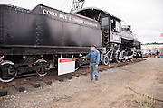 Dick Jamesguard, volunteer at the Oregon Coast Historical Railway museums, gives a tour to a train enthusiast.