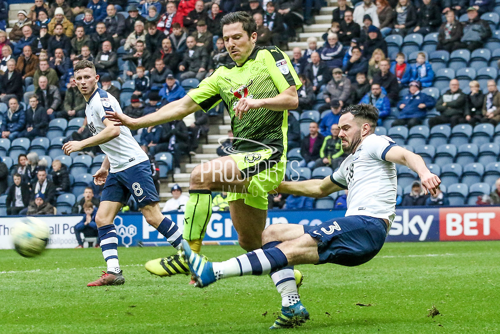 Preston North End Defender Greg Cunningham and Reading Striker Yann Kermorgant battle during the EFL Sky Bet Championship match between Preston North End and Reading at Deepdale, Preston, England on 11 March 2017. Photo by Pete Burns.