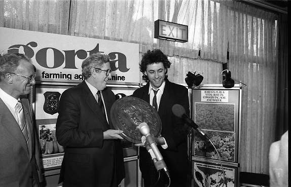 Bob Geldof Receives F.A.O.Medal..1986..16.10.1986..10.16.1986..16th October 1986..The highlight of Gorta's 21st anniversary World Food Day was the presentation of an F.A.O.(Food and Agriculture Organisation of the United Nations) to Bob Geldof. The medal was presented by An Taoiseach,Dr Garret Fitzgerald. The medal was in recognition of Bob's efforts and contribution towards famine relief in the Third World. The ceremony took place in The Berkeley Court Hotel in Dublin...Seen presenting Bob with his accolade is An Taoiseach, Dr Garret Fitzgerald, accompanied by Mr Ronald Smylie,Chief Executive of Gorta.