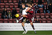Aberdeen FC Forward Adam Rooney and Hearts FC Defender Blazej Augustyn battle during the Scottish Cup fourth round match between Heart of Midlothian and Aberdeen at Tynecastle Stadium, Gorgie, Scotland on 9 January 2016. Photo by Craig McAllister.