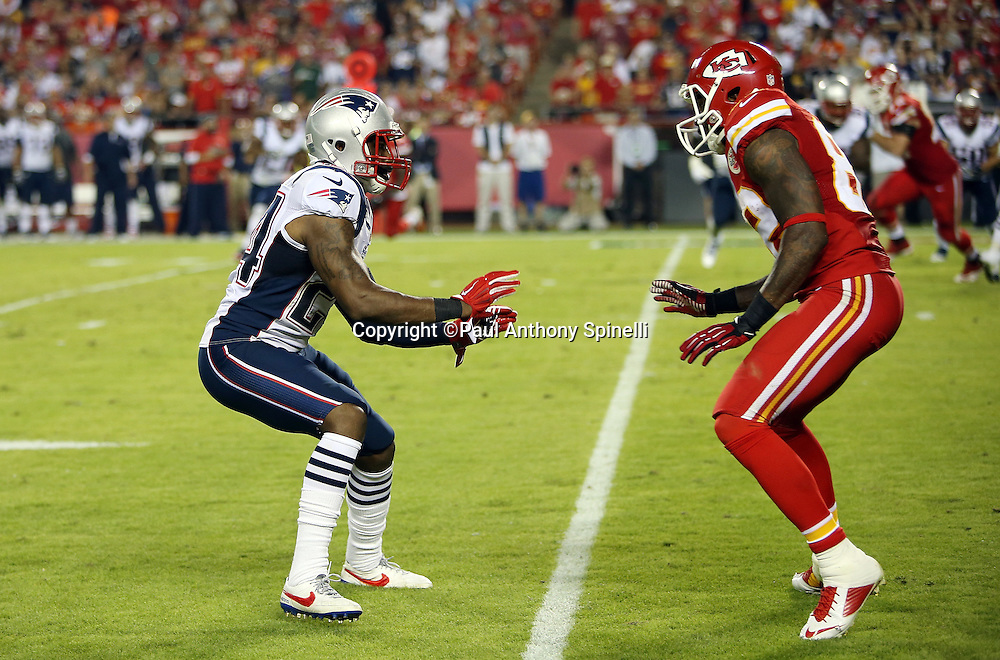 New England Patriots cornerback Darrelle Revis (24) covers Kansas City Chiefs wide receiver Dwayne Bowe (82) on a pass route during the NFL week 4 regular season football game against the Kansas City Chiefs on Monday, September 29, 2014 in Kansas City, Mo. The Chiefs won the game 41-14. ©Paul Anthony Spinelli