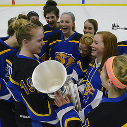 Staff photos by Tom Kelly IV<br /> East players celebrate with the cup following the Downingtown East vs Unionville girls Flyer's Cup Championship, Wednesday night March 19, 2014 at Ice Line in West Goshen.