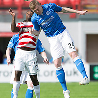 Hamilton Academical St Johnstone....04.04.15<br /> Brian Easton gets above Nigel Hasselbaink<br /> Picture by Graeme Hart.<br /> Copyright Perthshire Picture Agency<br /> Tel: 01738 623350  Mobile: 07990 594431