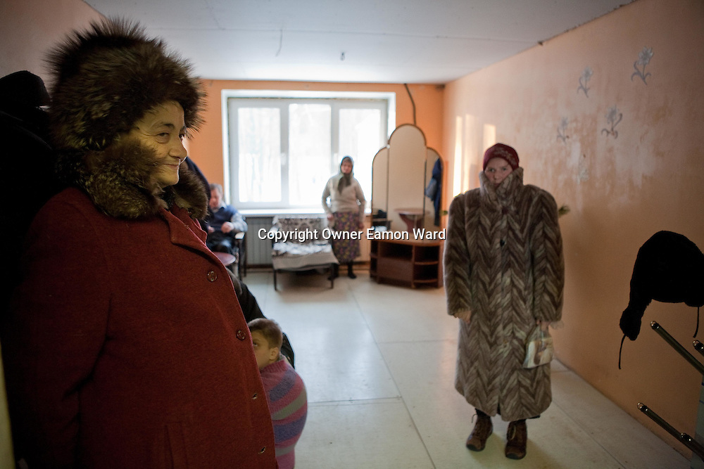 Patients in Soltanovka adult Mental Asylum in the Mogilev region of Belarus waiting to go for outdoor excercise. Chernobyl's human costs are widespread affecting about seven million people.A generation later children are being born with birth defects ,heart problems and thyroid cancer.The crippled economy of Belarus has led to poverty, social problems and domestic abuse.