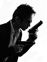one asian gunman killer portrait in silhouette isolated white background