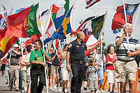 Larry Frates and Police Chief Chris Adams along with his son Quinn carry their respective flags of Portugal and Mexico as they greeted folks along the parade route during Laconia's Multicultural Day festivities Saturday.  (Karen Bobotas/for the Laconia Daily Sun)