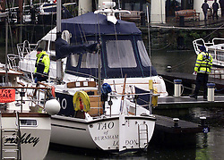 Police searching St Katherine's Docks, London, November 6, 2000. Photo by Andrew Parsons / i-images.