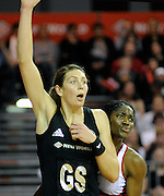 Irene Van Dyk looking for the ball, during New World Netball Series, New Zealand Silver Ferns v England at The ILT Velodrome, Invercargill, New Zealand. Thursday 6 October 2011 . Photo: Richard Hood photosport.co.nz