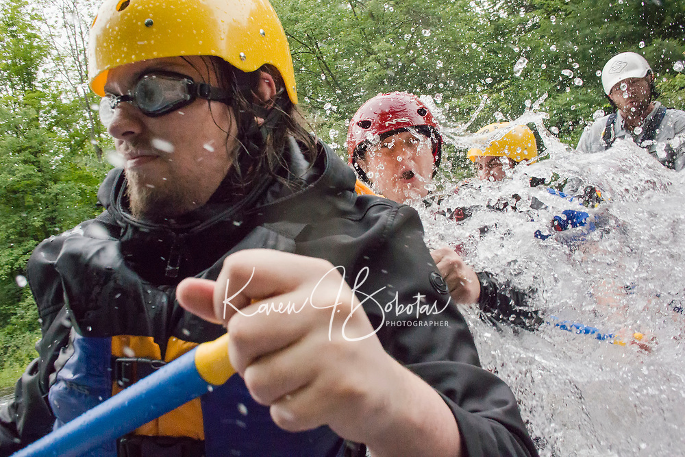 """Jon Hinson, Alicia Carroll, Abhas Joshi with guide Mardy Parichand of Outdoor New England paddle through the rapids on Winnipesaukee River in Franklin Saturday afternoon during Mill City Park's """"Winni River Days"""" whitewater festival.    (Karen Bobotas/for the Laconia Daily Sun)"""