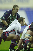 © Peter Spurrier/Intersport Images .Tel + 441494783165 email images@Intersport-images.com.29/11/2003 - Photo  Peter Spurrier.2003/04 Zurich Premiership Rugby - London Irish v Sale Sharks. Sharks skipper, Bryan Redpath, feeds the ball into the scrum, watched by counterpart Exiles Darren Edwards.