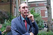 WILL SELF, Sebastian Horsley funeral. St. James's church. St. James. London afterwards in the church garden. July 1 2010. -DO NOT ARCHIVE-© Copyright Photograph by Dafydd Jones. 248 Clapham Rd. London SW9 0PZ. Tel 0207 820 0771. www.dafjones.com.