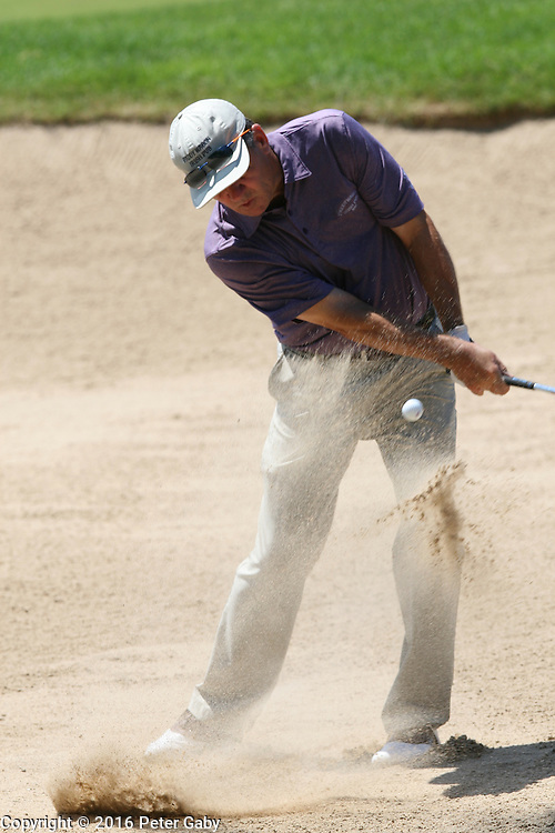 Scott Dunlap hitting out of the green side bunker on the 9th hole at the 2016 American Family Championship held at University Ridge Golf Course, Madison,  WI. on June 25, 2016.<br /> <br /> <br /> <br /> <br /> <br />  2016 American Family Championship held at University Ridge Golf Course, Madison,  WI. on June 25, 2016.