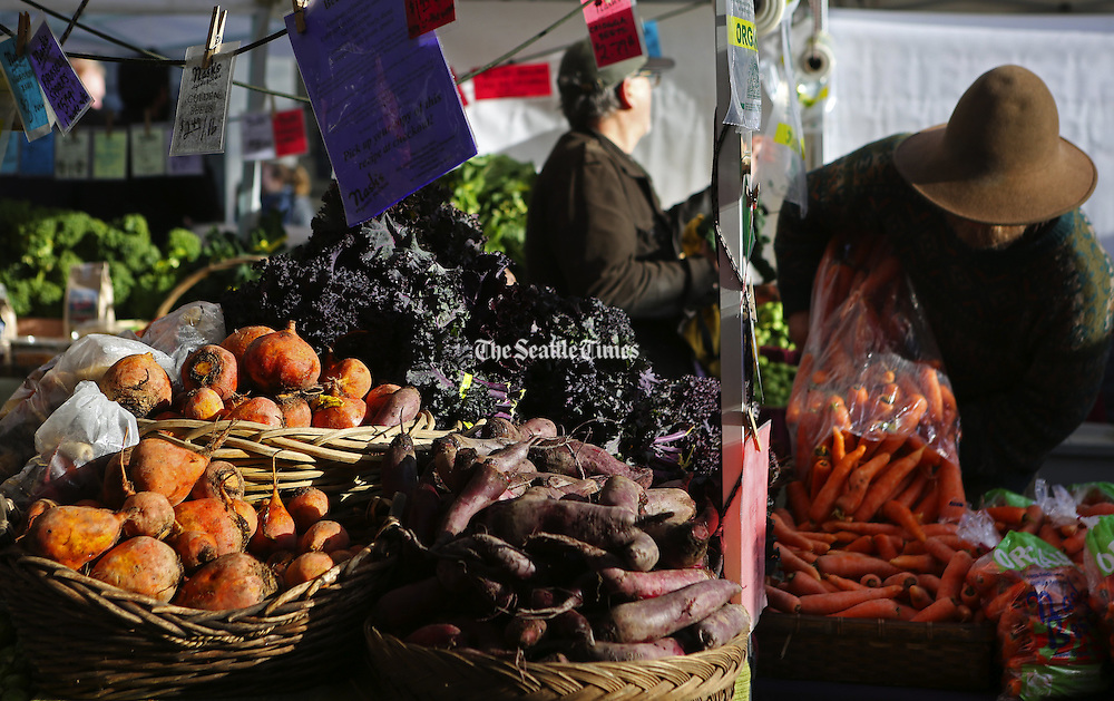 Beets at Nash's Organic Produce glow in the sunshine at the Ballard Farmers Market. (Ken Lambert / The Seattle Times)