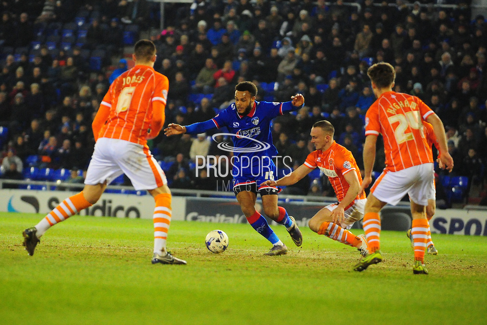 Aaron Holloway of Oldham Athletic (On loan from Wycombe Wanderers) heads past Tom Aldred of Blackpool FC during the Sky Bet League 1 match between Oldham Athletic and Blackpool at SportsDirect.Com Park, Oldham, England on 15 March 2016. Photo by Mike Sheridan.