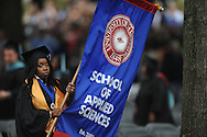 Jessica Stewart carries the banner for the University of Mississippi's School of Applied Sciences during graduation ceremonies in the Grove, in Oxford, Miss. on Saturday, May 11, 2013.