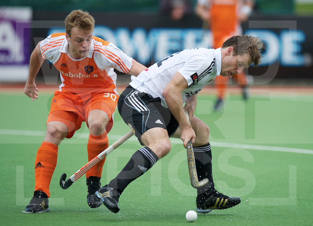 Netherlands Mink van de Weerden try to stop Christoph Menke,  during their Champions Trophy hockey match Netherlands against Germany  in Auckland, New Zealand, 01.12.2011. Foto: Frank Uijlenbroek
