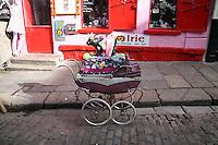 Traditional pram display outside botique fashion shop in Temple Bar Dublin Ireland