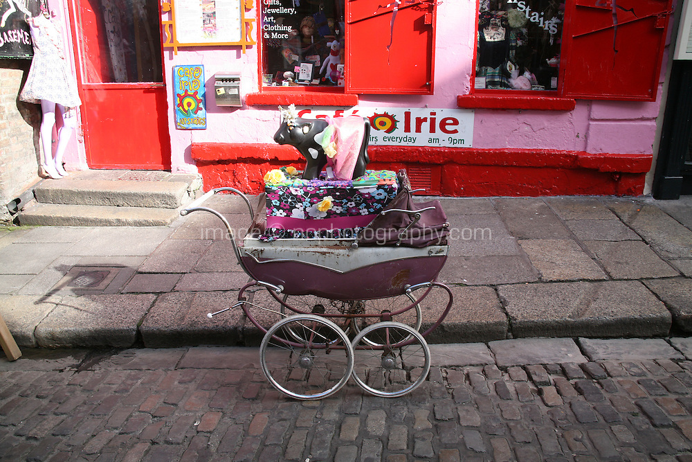 Traditional pram display outside botique fashion shop in Temple Bar Dublin Ireland