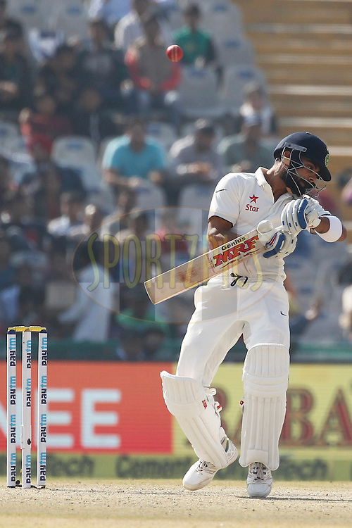 Virat Kohli Captain of India avoid bouncer during day 2 of the third test match between India and England held at the Punjab Cricket Association IS Bindra Stadium, Mohali on the 27th November 2016.<br /> <br /> Photo by: Deepak Malik/ BCCI/ SPORTZPICS