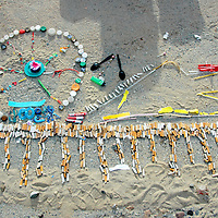 Members of Team Marine create a replica of the Santa Monica Pier using cigarettes and other trash they collected from the beach during their community outreach project at the Santa Monica Boardwalk on Saturday, January 14, 2012....Team Marine is a group of eco-minded students from Santa Monica High School who are advocates for the environment. They participate in various ocean stewardship/environmental science competitions, such as the QuikSCience Challenge, Edison Challenge, and the Solar Cup. Team Marine raise awareness about the global marine debris, energy and climate change crises through different service learning and community outreach projects. Team Marine was started and is coached by our Marine Biology teacher Benjamin Kay..