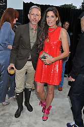 PATRICK COX and ELIZABETH SALTZMAN at the annual Serpentine Gallery Summer Party sponsored by Burberry held at the Serpentine Gallery, Kensington Gardens, London on 28th June 2011.