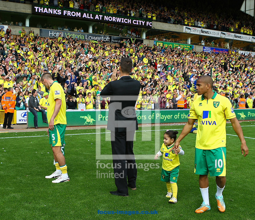 Picture by Paul Chesterton/Focus Images Ltd.  07904 640267.13/05/12.Steve Morison of Norwich and Simeon Jackson of Norwich with their children and Elliot Ward of Norwich on the lap of appreciation after the Barclays Premier League match at Carrow Road Stadium, Norwich.