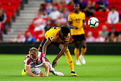 Cameron John of Wolverhampton Wanderers fouls Moritz Bauer of Stoke City - Mandatory by-line: Robbie Stephenson/JMP - 25/07/2018 - FOOTBALL - Bet365 Stadium - Stoke-on-Trent, England - Stoke City v Wolverhampton Wanderers - Pre-season friendly