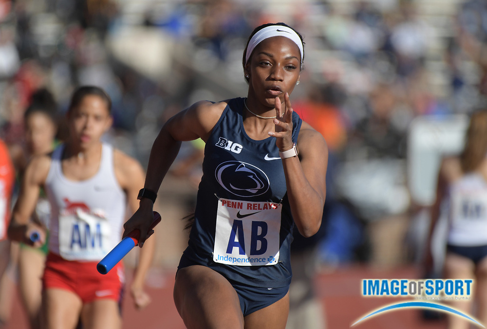 Apr 26, 2018; Philadelphia, PA, USA; Deja Davis runs the second 400m leg on the Penn State women's distance medley relay that placed third in 11:09.15 during the 124th Penn Relays at Franklin Field.