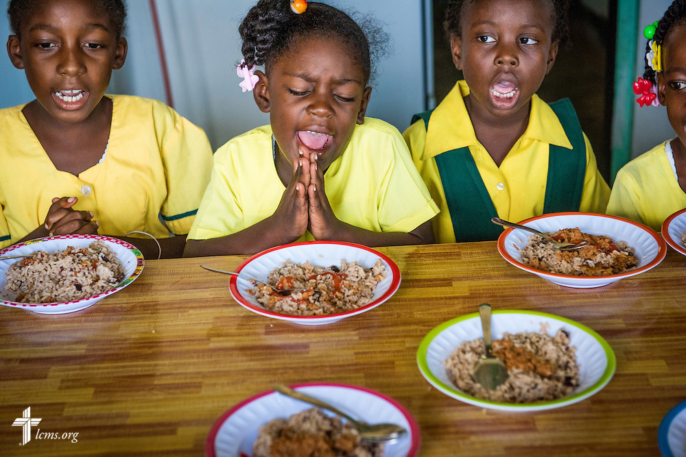 Young students pray before lunch provided by the Belize Mission Society at St. Alphonsus school on Tuesday, Sept. 27, 2016, in Seine Bight, Belize. LCMS Communications/Erik M. Lunsford