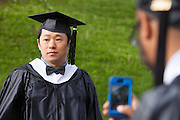 Won Suk Choi poses for a photograph before the start of the Master's and Doctorate Commencement ceremony at Ohio University Friday May 2, 2014.  Photo by Ohio University / Jonathan Adams