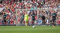 Football - 2017 / 2018 Premier League - Arsenal vs. West Ham United<br /> <br /> West Ham players look to each other after conceding their fourth goal at The Emirates.<br /> <br /> COLORSPORT/DANIEL BEARHAM