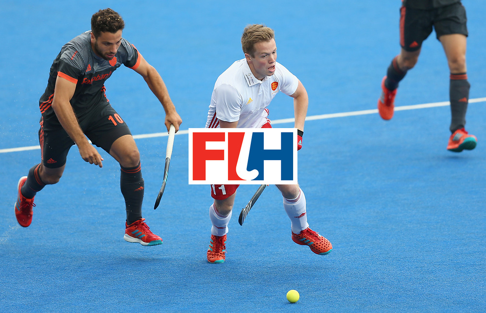 LONDON, ENGLAND - JUNE 24: Ian Sloan of England breaks away from Valentin Verga of the Netherlands during the semi-final match between England and the Netherlands on day eight of the Hero Hockey World League Semi-Final at Lee Valley Hockey and Tennis Centre on June 24, 2017 in London, England. (Photo by Steve Bardens/Getty Images)