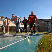Simpson alum Raymond Moore, 88, plays shuffleboard with Simpson football players at The Village retirement complex in Indianola.  From left are Jake Harre, Taylor Stockdale, Moore and J.J. Nair.