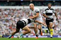 Joe Simpson (England) is tackled in possession - Photo mandatory by-line: Patrick Khachfe/JMP - Tel: Mobile: 07966 386802 01/06/2014 - SPORT - RUGBY UNION - Twickenham Stadium, London - England XV v Barbarians - International Friendly.