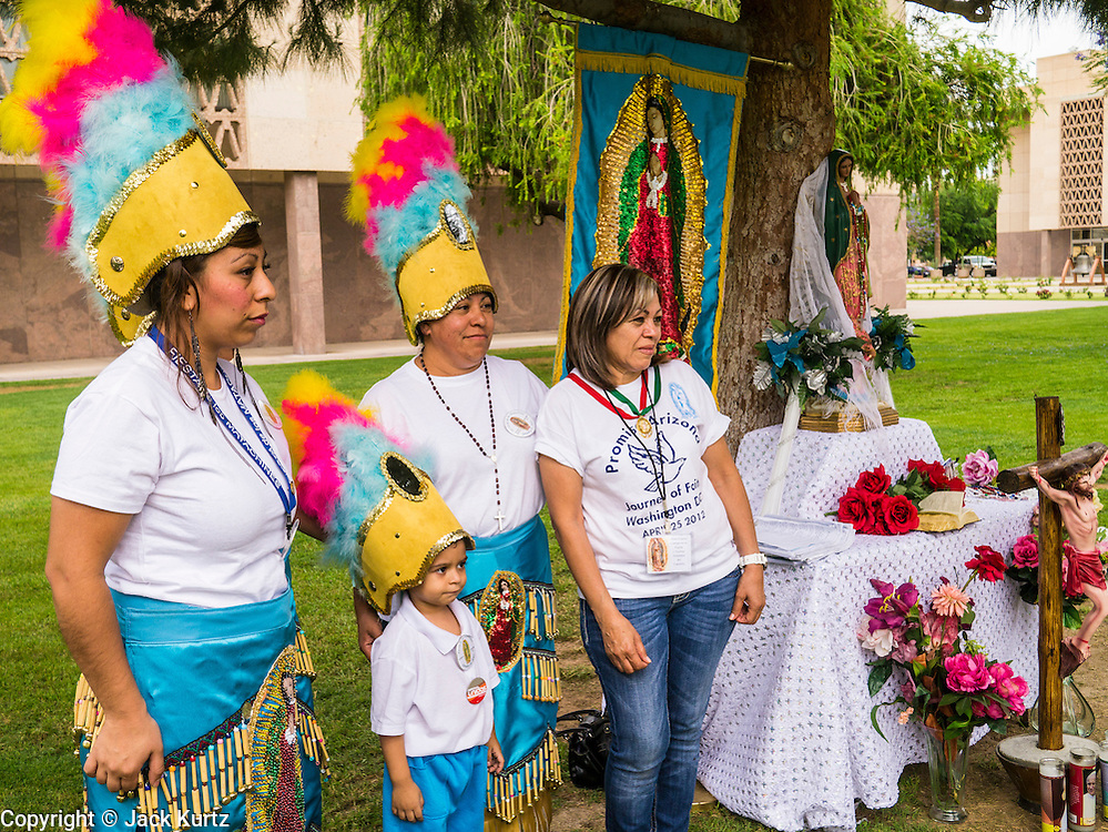 25 APRIL 2012 - PHOENIX, AZ: Matachine dancers gather at the Arizona State Capitol Wednesday before a prayer vigil to oppose SB1070. Immigrants' rights groups opposed to SB1070 and Tea Party affiliated groups that support SB1070 gathered at the state capitol in Phoenix Wednesday to express their opposition and support of the bill. SB1070 was signed by Arizona Governor Jan Brewer in April 2010. At the time it was the toughest anti-illegal immigration bill in the country. Immigrants' rights groups sued Arizona and the federal courts stopped enforcement of the bill. The bill ended up in the US Supreme Court which heard arguments Wednesday. A ruling on the bill is expected in June.    PHOTO BY JACK KURTZ