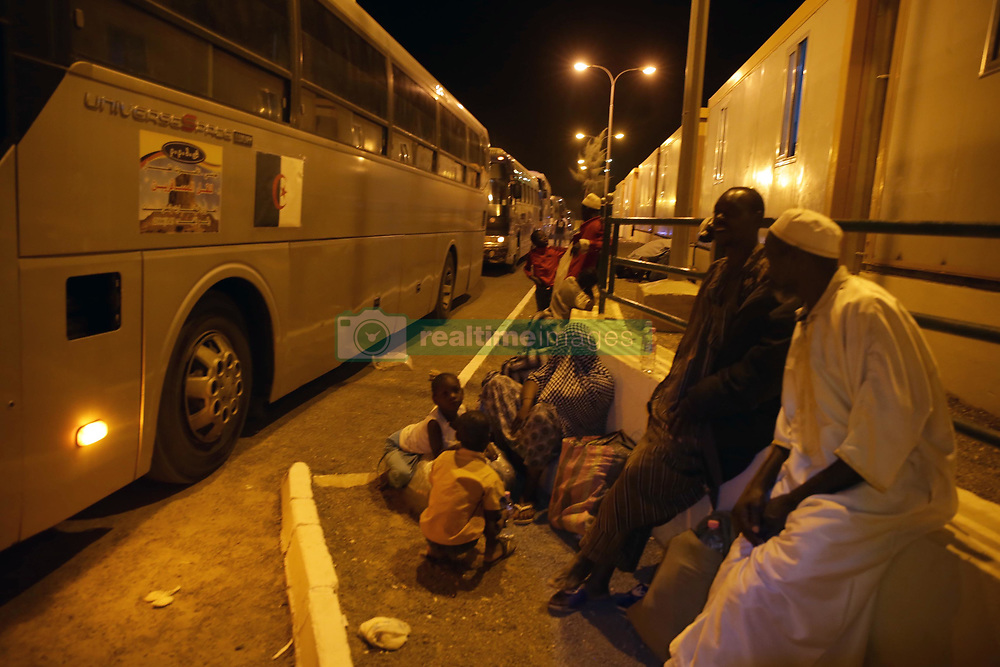 July 2, 2018 - Tamanrasset, Algeria - African migrants who will be repatriated to their country by the Algerian government from the temporary refuge center, near the Niger border in Tamanrasset, Algeria, on 02 July 2018. The Algerian government has started the Repatriation process Thousands of migrants have arrived in Algeria, mainly from Niger  (Credit Image: © Billal Bensalem/NurPhoto via ZUMA Press)