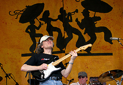 30 April 2006. New Orleans, Louisiana. Jazzfest . <br /> The first New Orleans Jazz and Heritage festival following the disaster of Hurricane Katrina. <br /> Legendary guitarist Sonny Landreth on the Acura stage.<br /> Photo ©Charlie Varley/varleypix.com<br /> All rights reserved.