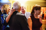 "Photo by Matt Roth.Assignment ID: 10137379A..Jackie Clegg, left, touches the collar of her husband Chris Dodd, the Chairman and CEO of the Motion Picture Association of America while they talk with PBS journalist Jim Lerher while waiting in the receiving line of Buffy and Bill Cafritz, Ann and Vernon Jordan, Vicki and Roger Sant inaugural ""Bi-Partisan Celebration"" at the Dolley Madison Ballroom at the Madison Hotel in Washington, D.C. on Sunday, January 20, 2013."