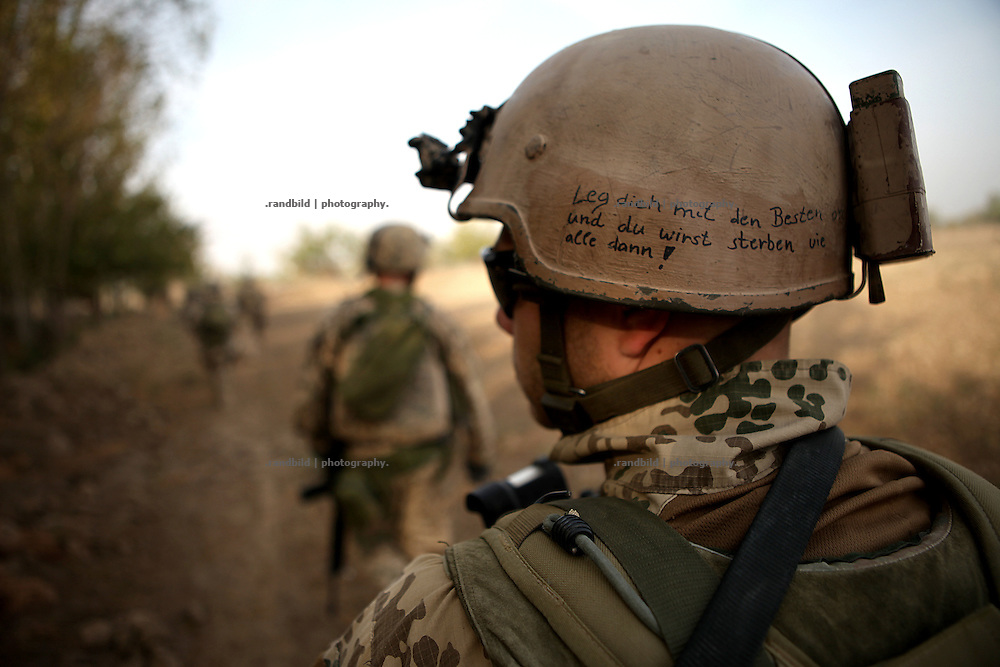 "Written on the helmet: ""Leg dich mit den Besten an und du wirst sterben wie alle dann!"". Joint patrol of german Bundeswehr and Afghan National Army in and around Nawabad. By rising presence ISAF wants to push out remain Taliban and occupy the former insurgent held region of Chahar Darah. Soldiers talk to local, recruit informers, check cars and try to figure out essential needs of Nawabads local polupaltion. late October 2011 Kunduz based 3.Task Force started a several days operation in and around Nawabad (District Chahar Darah), west of Kunduz, northern Afghanistan. During the Operation Orpheus about 100 german infantery soldiers rolled out for patrols through the town and surrounding areas, which were expected as a retreat zone of insurgents."
