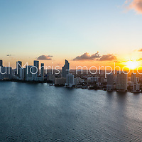 Aerial view of Miami at sunset featuring the Edgwater neighborhood north of downtown Miami on Biscayne Bay. This version is watermarked, contact us to license and clean version.