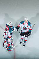 KELOWNA, CANADA - APRIL 8: Nick Merkley #10 and Michael Herringer #30 of the Kelowna Rockets celebrate an empty net goal in the third period against the Portland Winterhawks on April 8, 2017 at Prospera Place in Kelowna, British Columbia, Canada.  (Photo by Marissa Baecker/Shoot the Breeze)  *** Local Caption ***