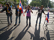 30 NOVEMBER 2013 - BANGKOK, THAILAND:  Anti-government students from Ramkhamhaeng University in Bangkok form a road block to stop pro-government Red Shirts from entering their campus Satuday. Political faultlines in Bangkok, the Thai capital, hardened Saturday. Antigovernment factions repeated promises to strike at the heart of Bangkok Sunday and bring down the government while thousands of Red Shirts, who support the government, have come to Bangkok from their base in rural Thailand to defend the government. Prime Minister Yingluck Shinawatra has appealed for calm, but her opponents have rejected all requests for negotiations saying the only acceptable outcome is the eradication of the government.       PHOTO BY JACK KURTZ