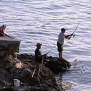Fishing is not only a favorite pastime for Cubans but it is also an income source. Fishermen looking for a catch near the mouth the river Almendares.   Photography by Jose More