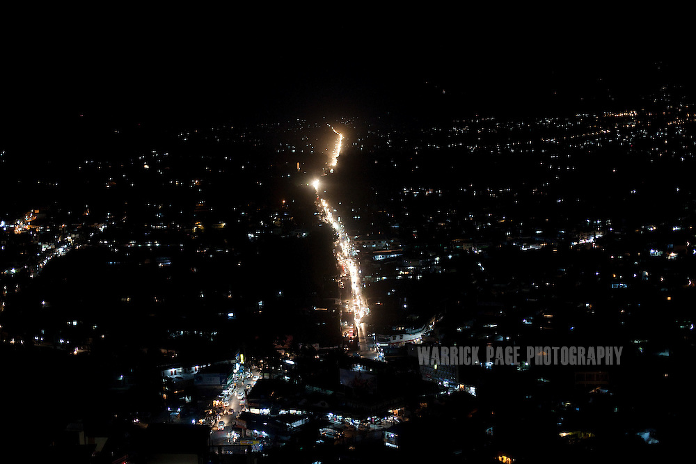 Night view of Abbottabad from Sardan Hills, on May 9, 2011 in Abbottabad, Pakistan. The town of Abbottabad became infamous after the US launched a midnight raid on a compound housing Osama bin Laden in the garrison town, on May 2, 2011. The operation, code-named Operation Neptune Spear, was launched from neighbouring Afghanistan and resulted in the killing of one of the world's most notorious terrorists and who claimed responsibility for the 9/11 attacks in the US. U.S. forces took bin Laden's body to Afghanistan for identification, then dumped it the Arabian Sea. Pakistan has since been widely suspected as having prior knowledge of his whereabouts as the compound was less than a kilometre from the country's biggest military academy. (Photo by Warrick Page)