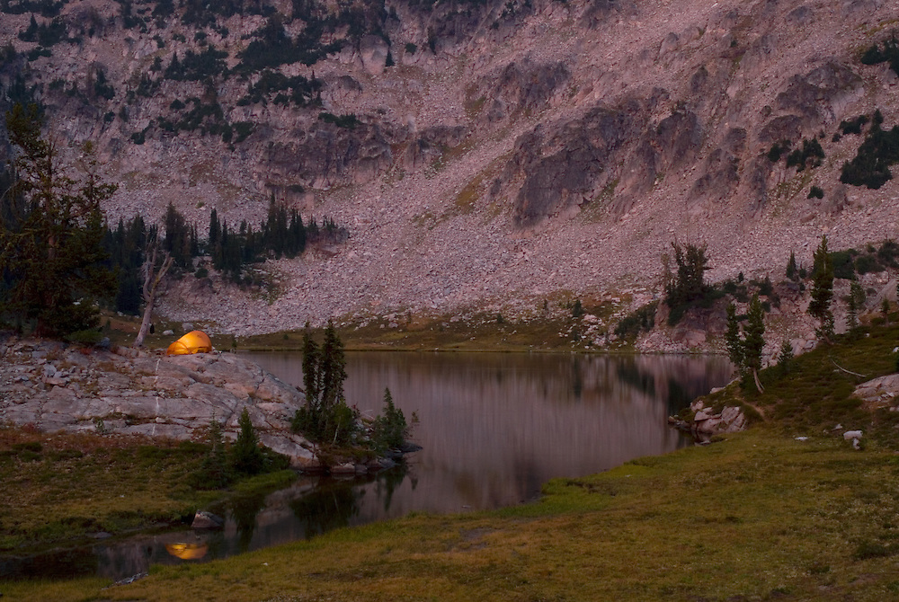 Evening scene with backpacker's camp next to a mountain lake in Oregon's Wallowa Mountains.