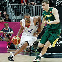 02 August 2012: Tony Parker of France drives past Lithuania Martynas Pocius during 82-74 Team France victory over Team Lithuania, during the men's basketball preliminary, at the Basketball Arena, in London, Great Britain.